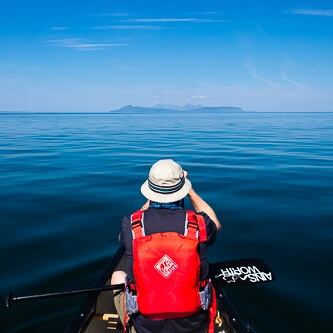 Bow canoeist looking towards Small Isles