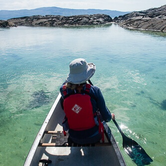 Canoeing through turquoise waters